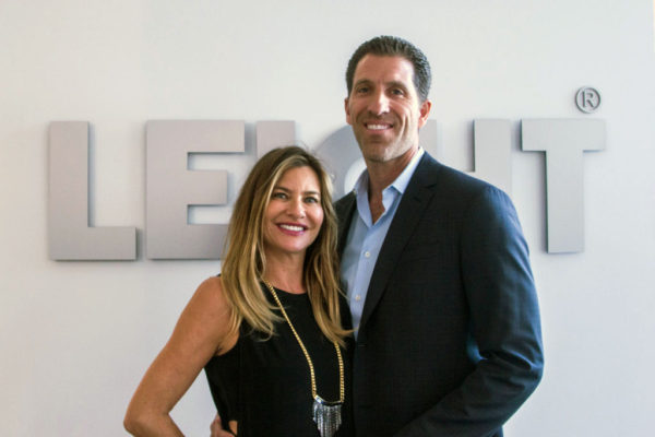 happy couple in front of leicht sign