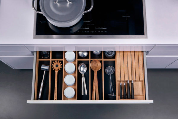 overview of modern kitchen cabinets and stove