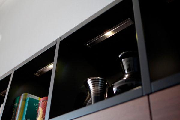open shelving with overhead lighting