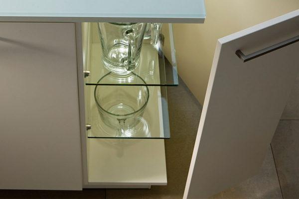 glass shelves on a kitchen island