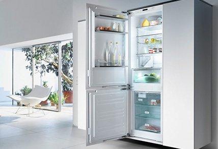 modern kitchen with open fridge