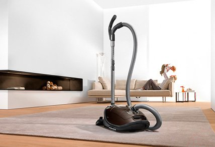 vacuum in a contemporary living room and fireplace