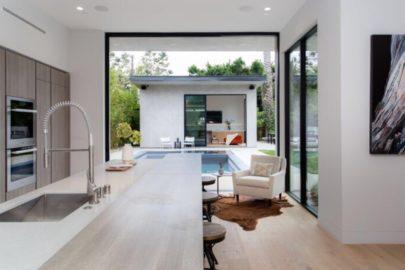 modern kitchen leading to beautiful backyard